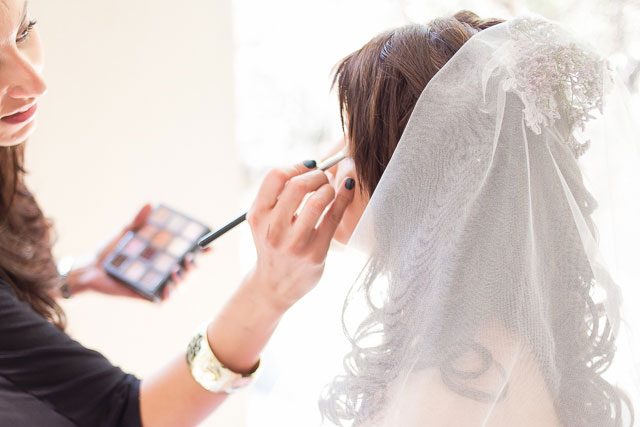 Makeup Artist behind the scenes application at Anke Maseko's Wedding