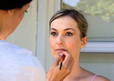 Behind the scenes makeup application on a bridesmaid at Woune Muller's Wedding